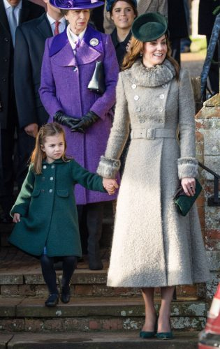 Princess Charlotte attempts a curtsey standing next to Kate Middleton during Christmas Day church service in 2019