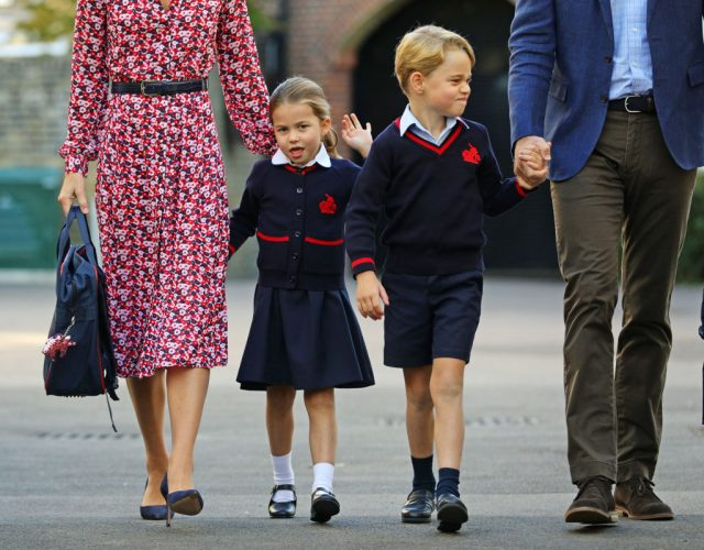 Princess Charlotte waves as she and Prince George arrive at school