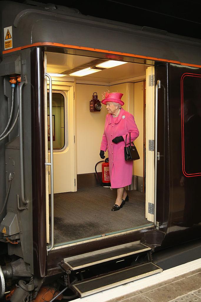 Queen Elizabeth II  exiting royal train