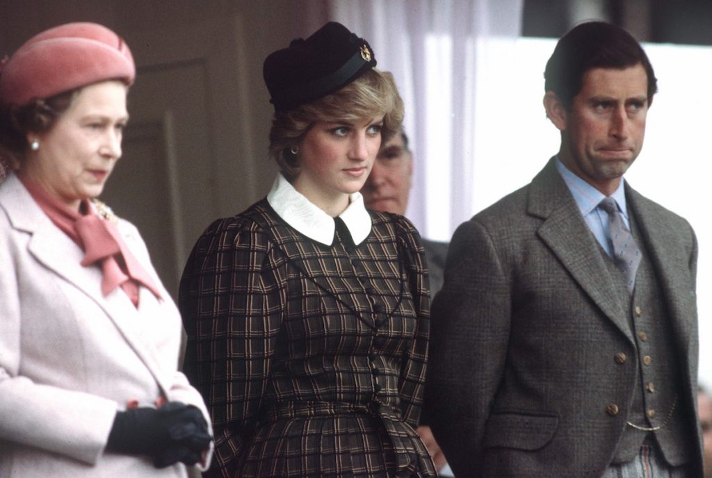 Queen Elizabeth Ll With Princess Diana And Prince Charles Watching The Traditional Highland Games At Braemar.