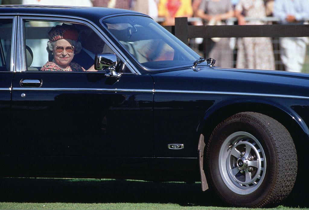 Queen Elizabeth II driving in her car