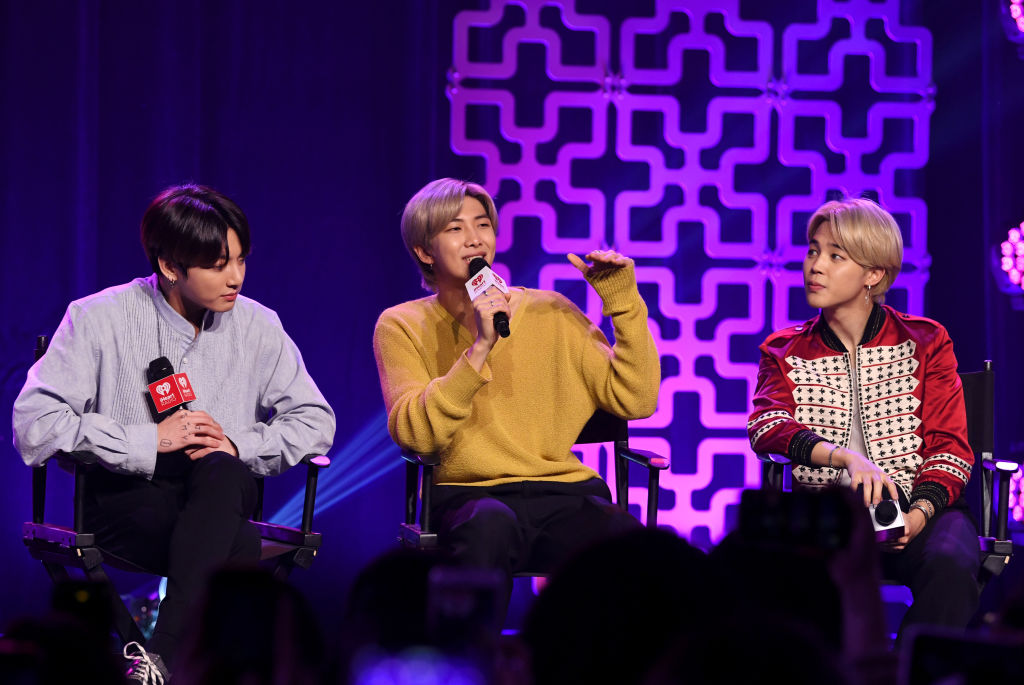 Jungkook, RM, and Jimin of BTS speak onstage at iHeartRadio LIVE with BTS