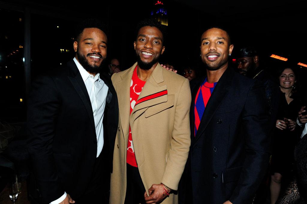 Ryan Coogler, Chadwick Boseman and Michael B. Jordan smiling at the camera