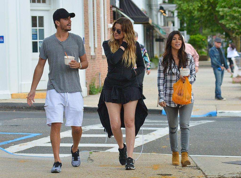 Scott Disick, Khloé Kardashian, Kourtney Kardashian walking down a sidewalk