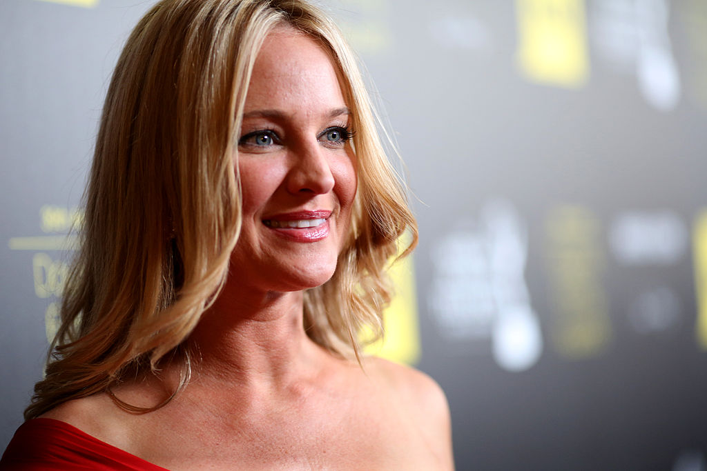 Sharon Case looking away from the camera, smiling