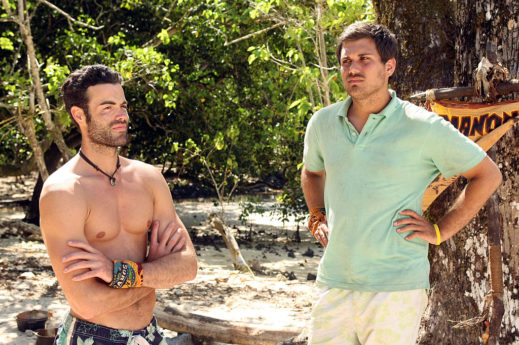 Michael Jefferson and Colton Cumbie standing on a beach on 'Survivor'