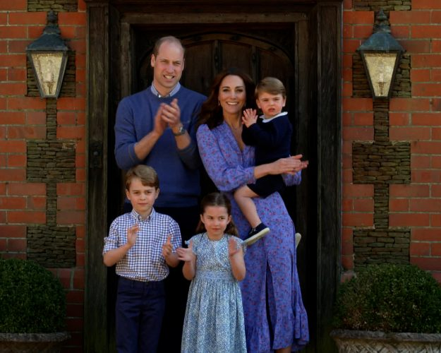 The Duke and Duchess of Cambridge clap with their children