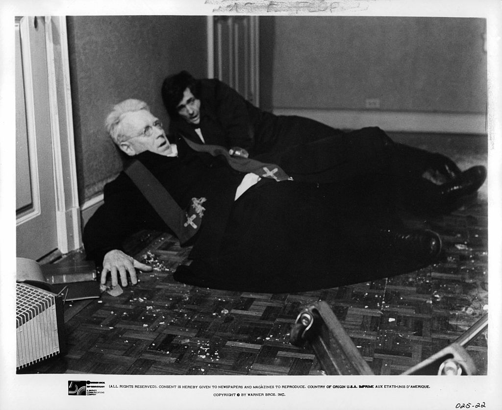 Max Von Sydow and Jason Miller lay on floor after being thrown from bed in a scene from the film 'The Exorcist'