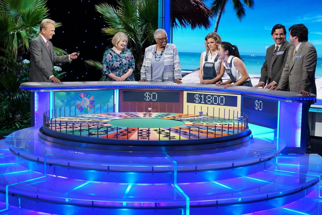 Pat Sajak and contestants on 'Wheel of Fortune'