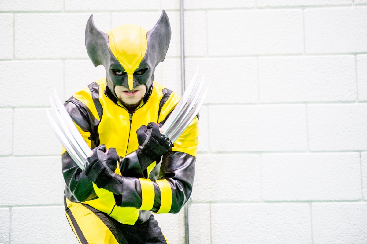 A cosplayer in character as Wolverine