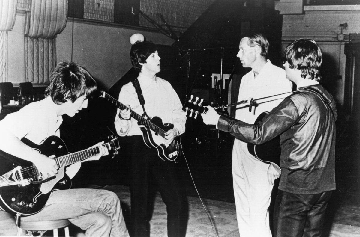 Beatles working with producer George Martin in the studio