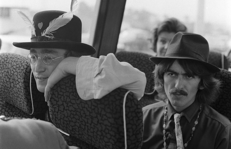 Beatles Lennon and Harrison on a bus