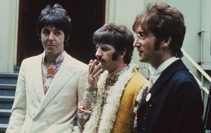 Beatles Paul, Ringo, and John stand outside Abbey Road studios