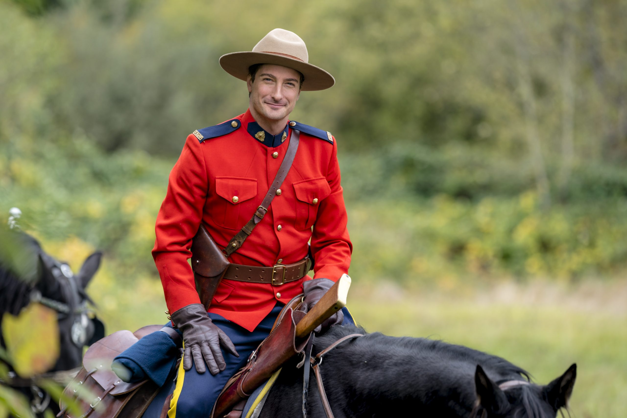 Daniel Lissing, as Jack, riding a horse in When Calls the Heart