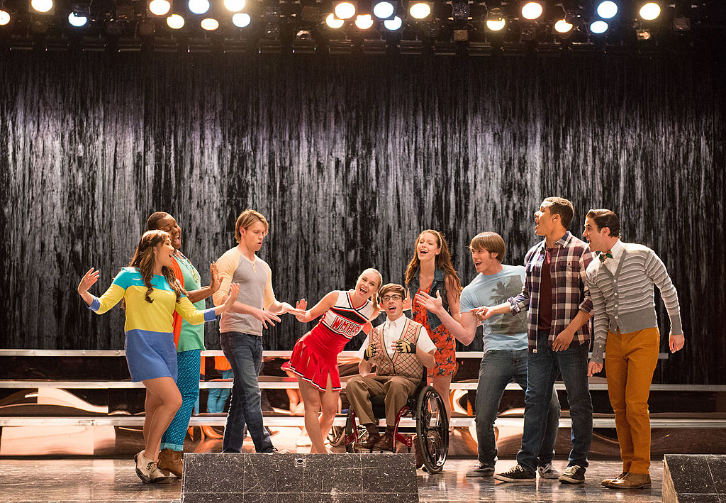 "(L-R) Jenna Ushkowitz, Alex Newell, Chord Overstreet, Becca Tobin, Kevin McHale, Melissa Benoist, Blake Jenner, Jacob Artist and Darren Criss star in the ""Lights Out"" episode of GLEE"