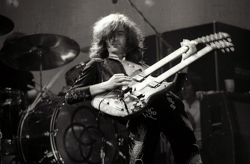 Jimmy Page playing his double-neck guitar onstage