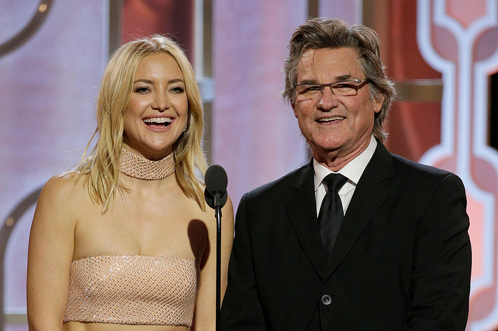 Kate Hudson and Kurt Russell speak onstage during the 73rd Annual Golden Globe Awards at The Beverly Hilton Hotel on January 10, 2016 in Beverly Hills, California.