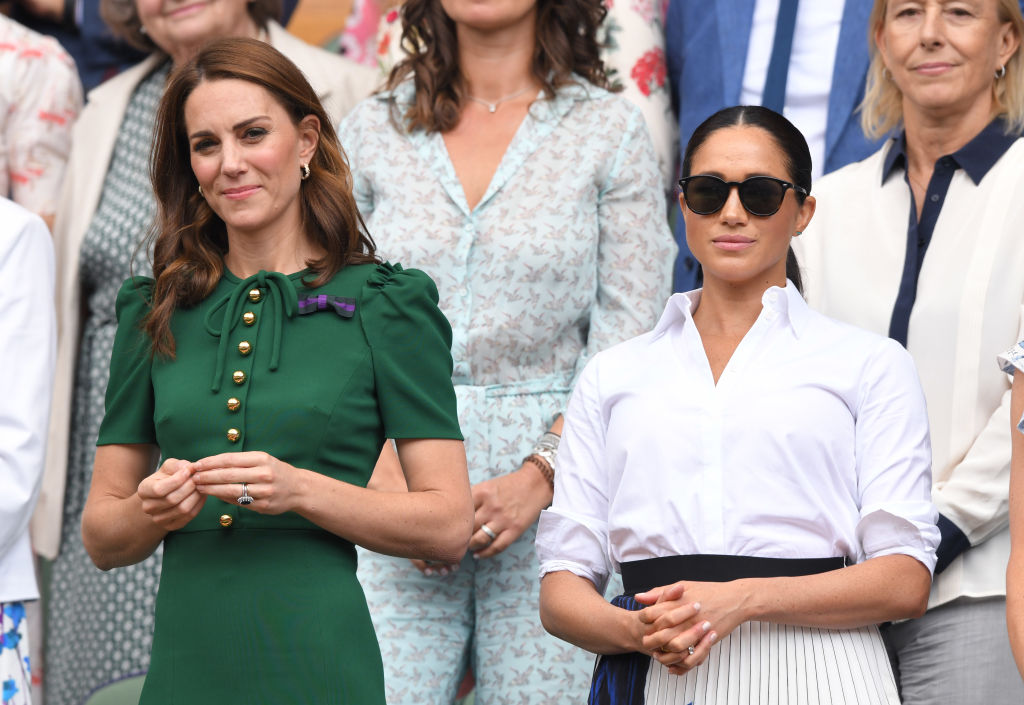 Kate Middleton and Meghan Markle in the Royal Box on Centre Court during day twelve of the Wimbledon Tennis Championships