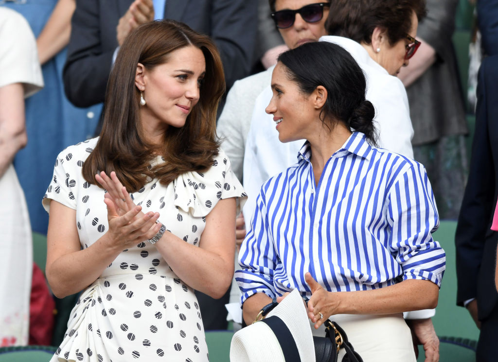 Kate Middleton and Meghan Markle attend day twelve of the Wimbledon Tennis Championships at the All England Lawn Tennis and Croquet Club