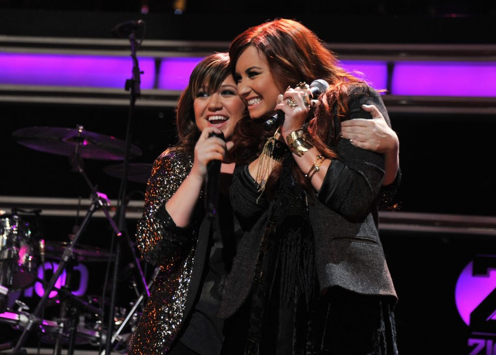 Singers Kelly Clarkson and Demi Lovato perform onstage during Z100's Jingle Ball 2011 at Madison Square Garden.