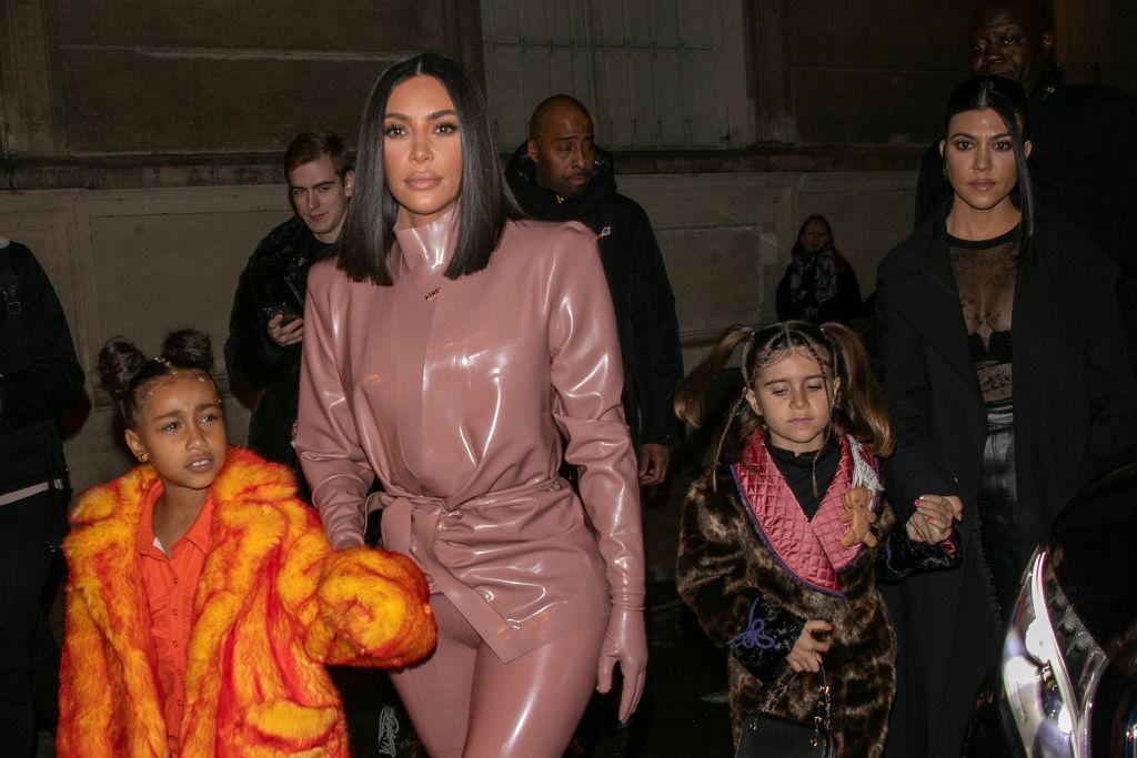 Kim Kardashian West, North West, Penelope Disick, and Kourtney Kardashian arrive at FERDI restaurant in Paris