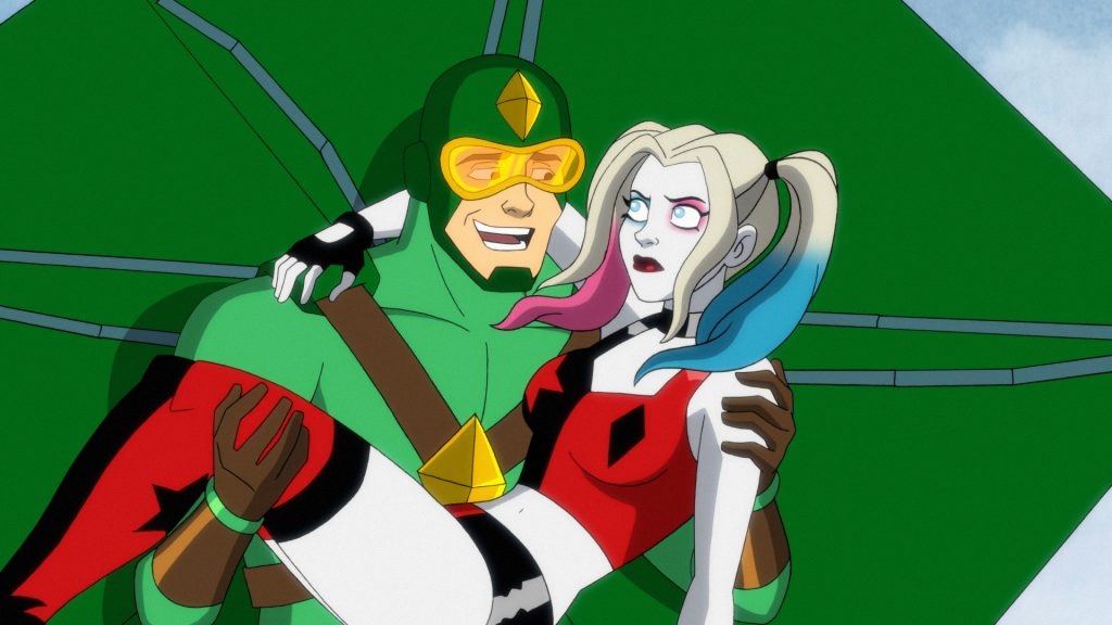 Kiteman carries Harley Quinn away from a mind-controlled Poison Ivy