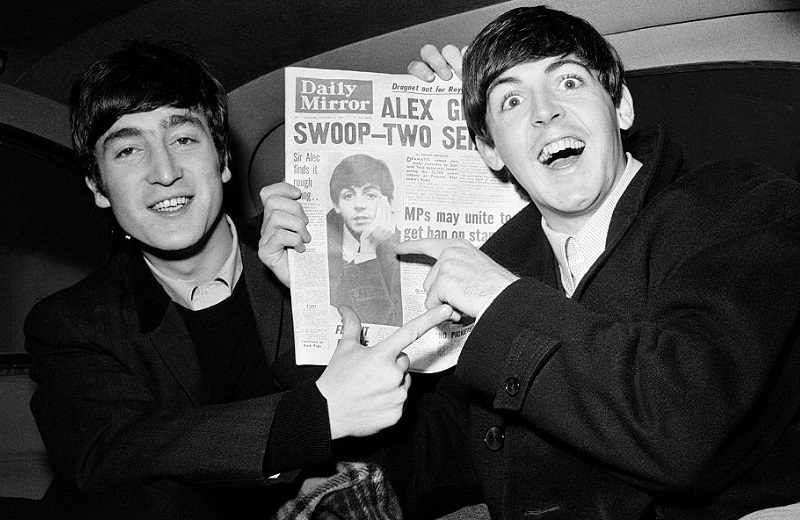 John Lennon and Paul McCartney have a laugh in '63