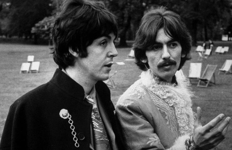 Paul McCartney and George Harrison walking and talking