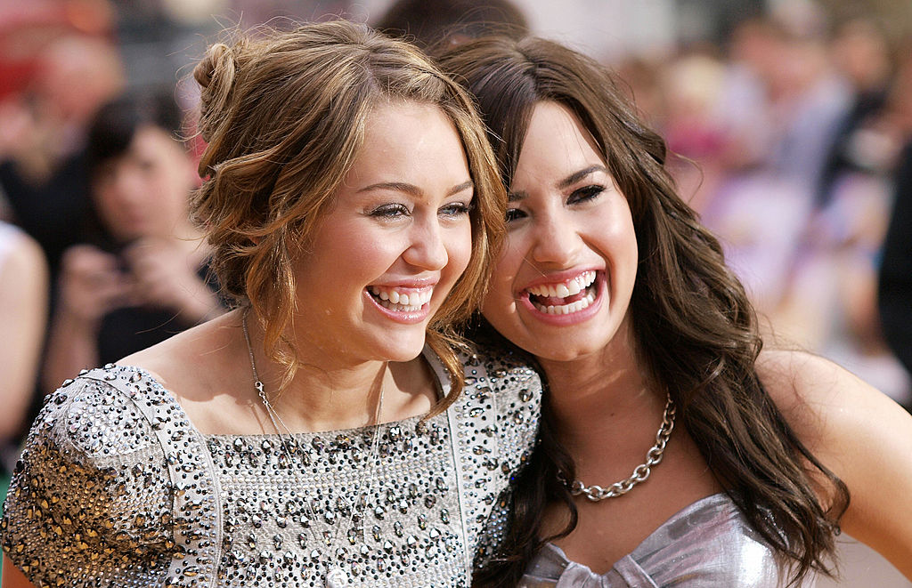 Miley Cyrus (L) and Demi Lovato at the 'Hannah Montana' premiere in London on April 23, 2009