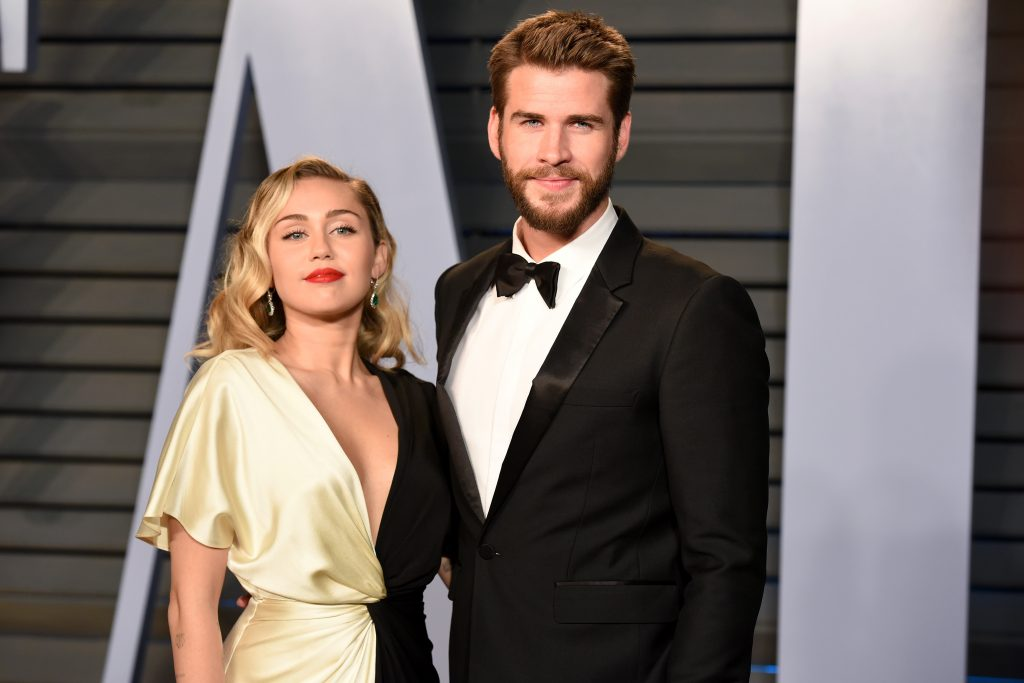 Miley Cyrus and Liam Hemsworth attend the 2018 Vanity Fair Oscar Party on March 4, 2018 in Beverly Hills, CA.