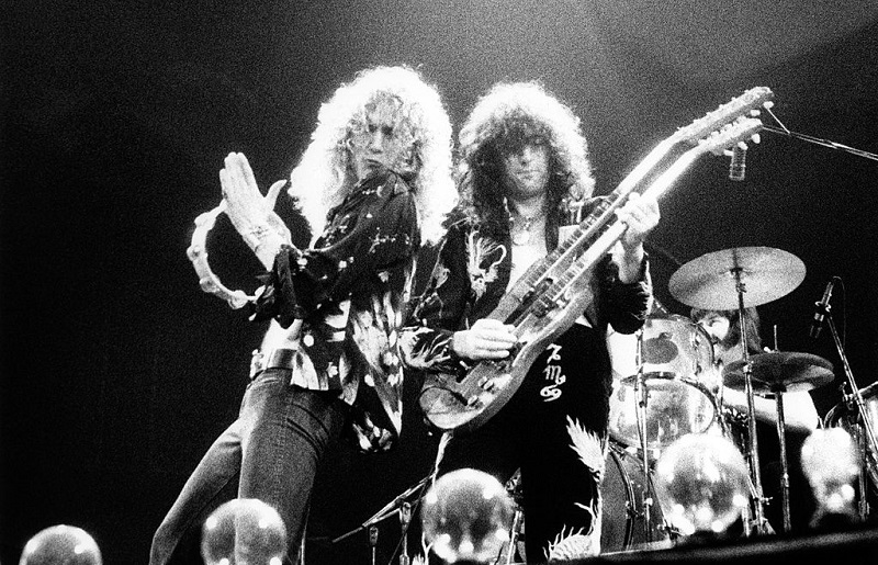Robert Plant and Jimmy Page performing onstage with Led Zeppelin