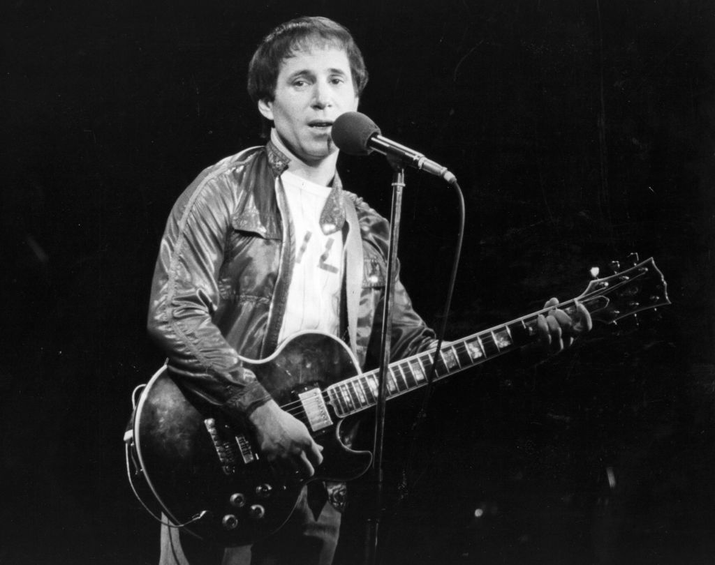 Paul Simon with a guitar