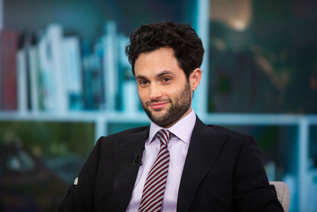 Penn Badgley wearing a suit and tie