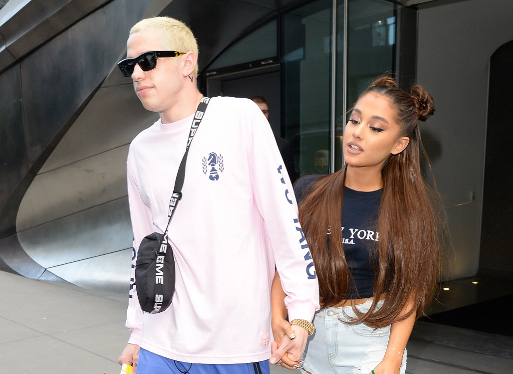 Singer Ariana Grande (R) and Pete Davidson are seen walking in Midtown on July 11, 2018 in New York City.