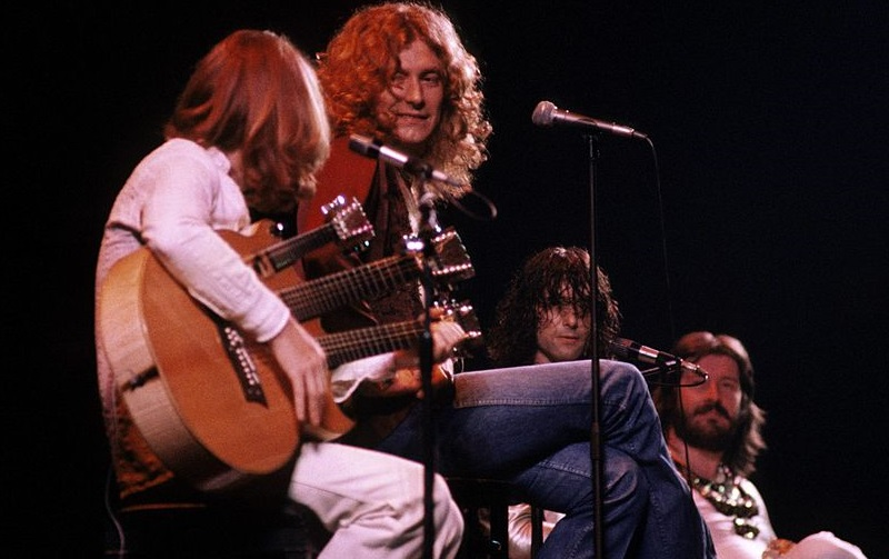 Led Zeppelin seated onstage in 1977