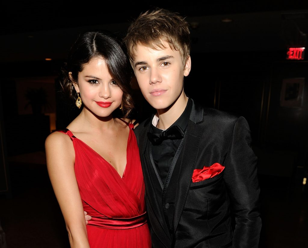 Selena Gomez and Justin Bieber attend the 2011 Vanity Fair Oscar Party