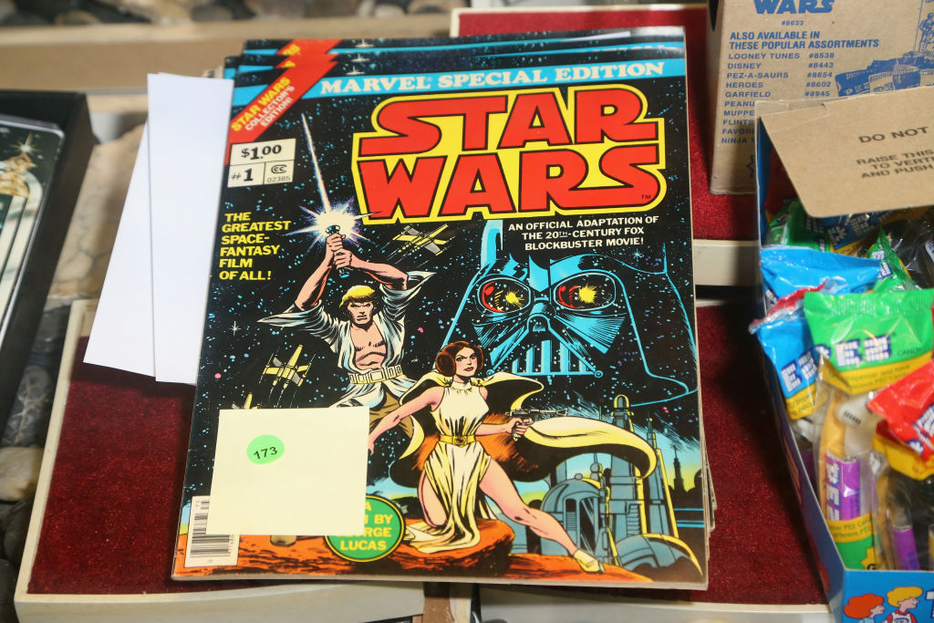 """1977 special edition """"Star Wars"""" comic books once owned by Carrie Fisher are displayed during an auction of Debbie Reynolds and Carrie Fisher items at McManus Auctions on February 11, 2018."""