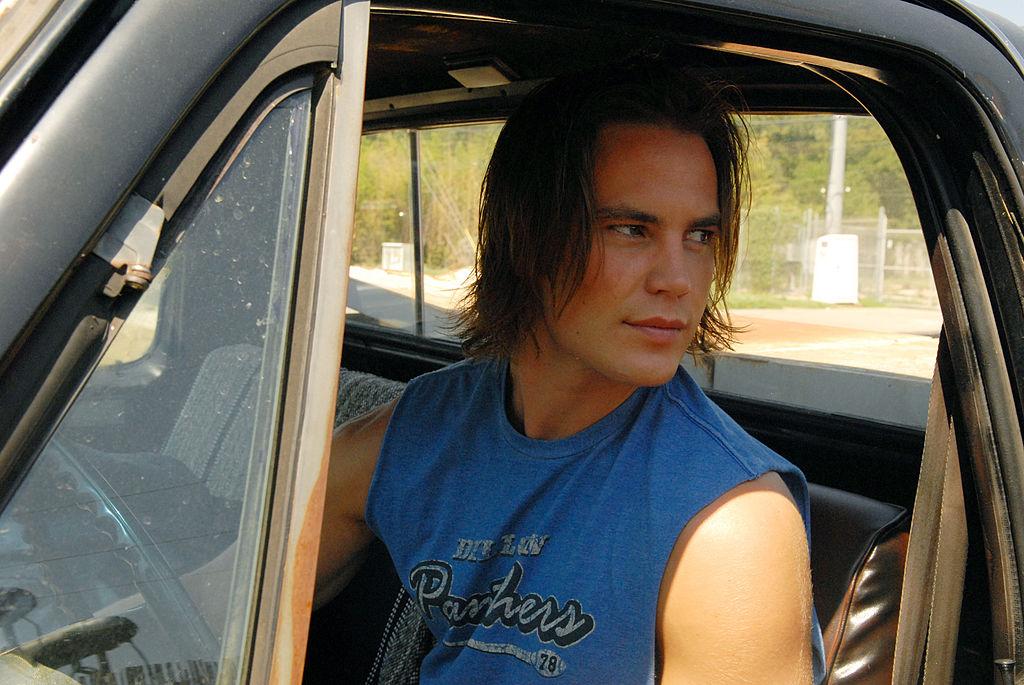 Tim Riggins in a truck