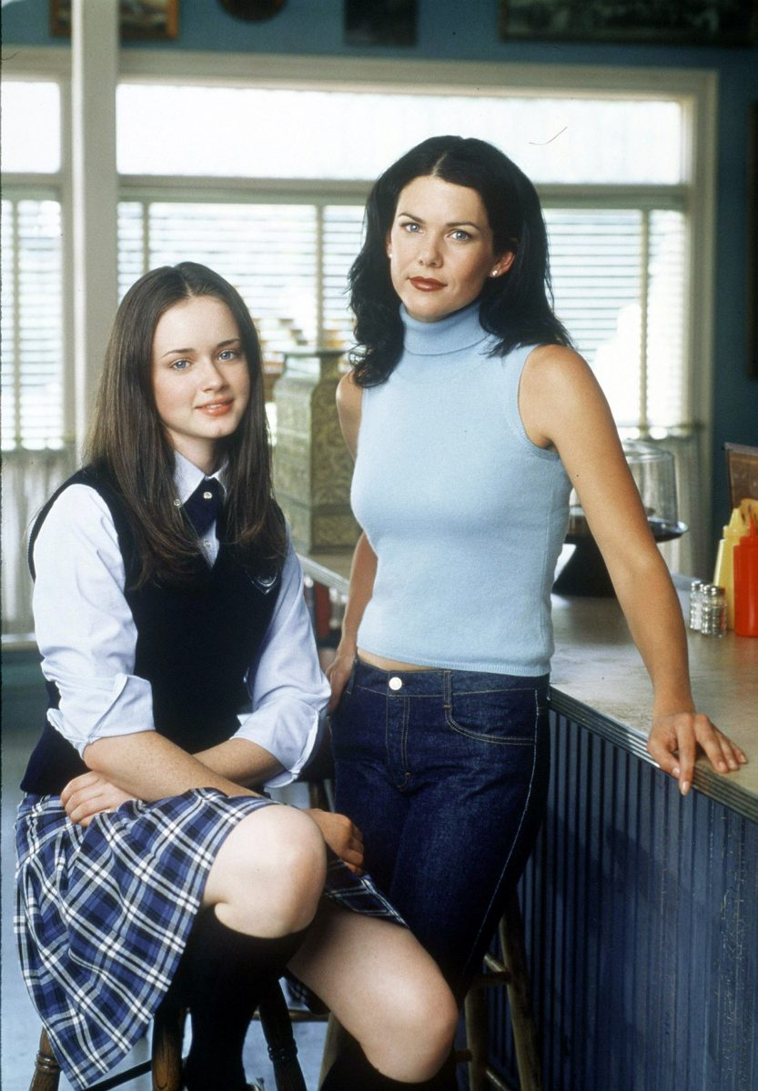 Alexis Bledel and Lauren Graham pose on the set of 'Gilmore Girls' as Rory and Lorelai Gilmore