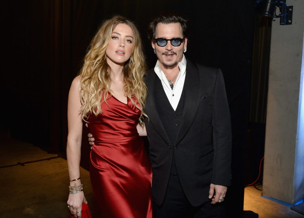 Amber Heard and Johnny Depp smiling