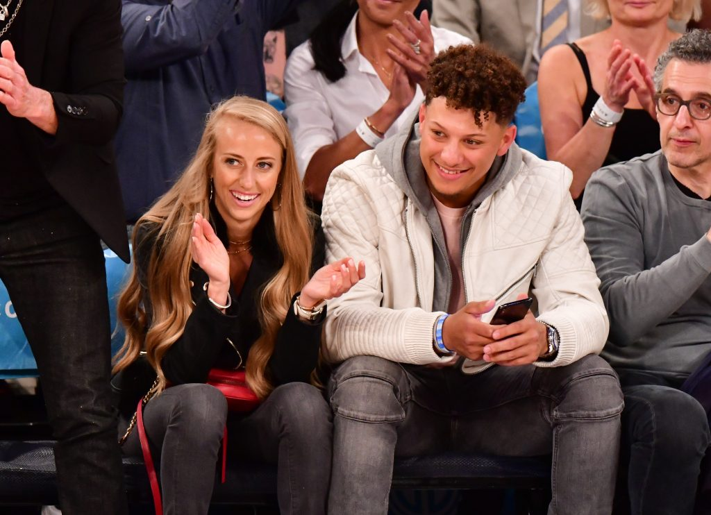 Patrick Mahomes and Brittany Mathews watching an NBA game