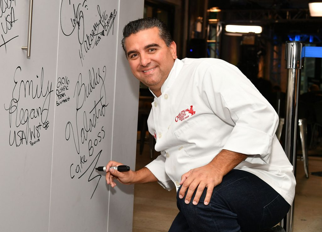 Buddy Valastro signing the wall at AOL HQ