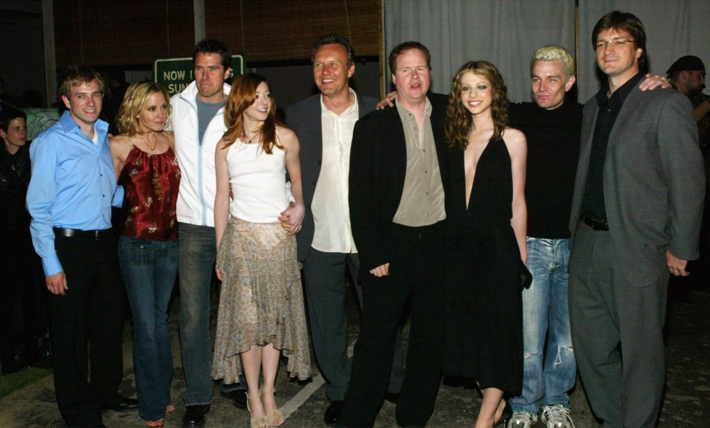 'Buffy the Vampire Slayer' season 7 cast with Joss Whedon, smiling in different directions