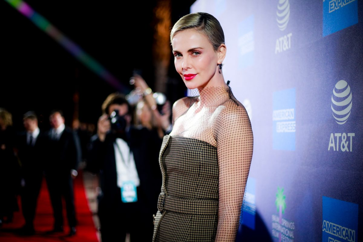 Charlize Theron poses on the red carpet at the 2020 Palm Springs International Film Festival Film Awards Gala