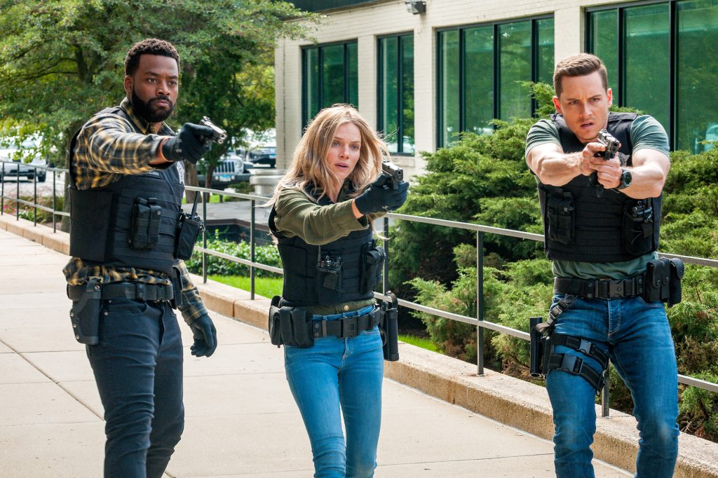 (L-R) LaRoyce Hawkins as Officer Kevin Atwater, Tracy Spiridakos as Det. Hailey Upton, Jesse Lee Soffer as Det. Jay Halstead with prop guns drawn