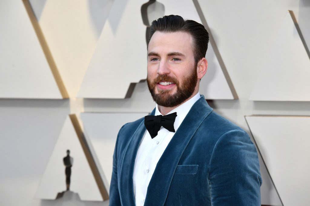 Chris Evans smiling and looking off camera
