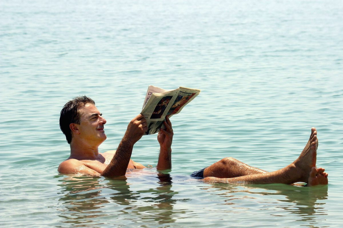 Chris Noth floats in the Dead Sea in 2004