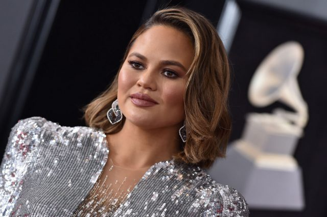Chrissy Teigen Calls Out American Airlines, Claims Company Only 'Cares About Money'