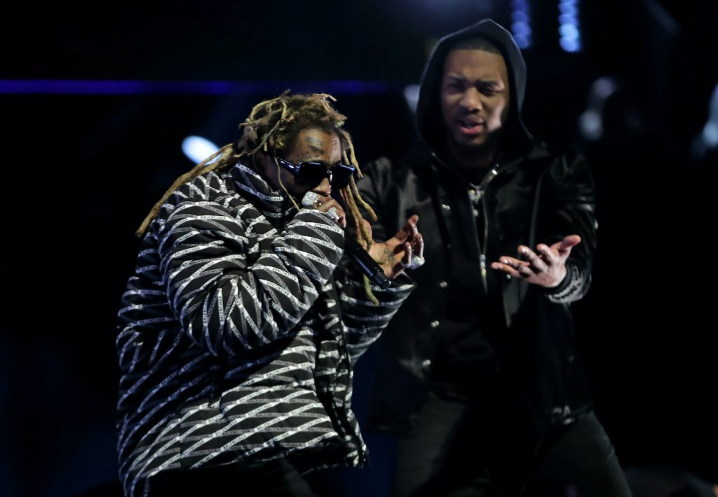 Lil Wayne performs with Damian Lillard in the 2020 NBA All-Star - AT&T Slam Dunk Contest during State Farm All-Star Saturday Night at the United Center