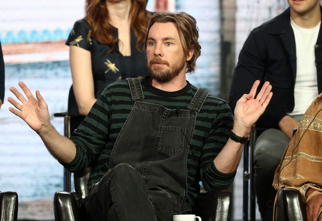 Dax Shepard holding his hands up